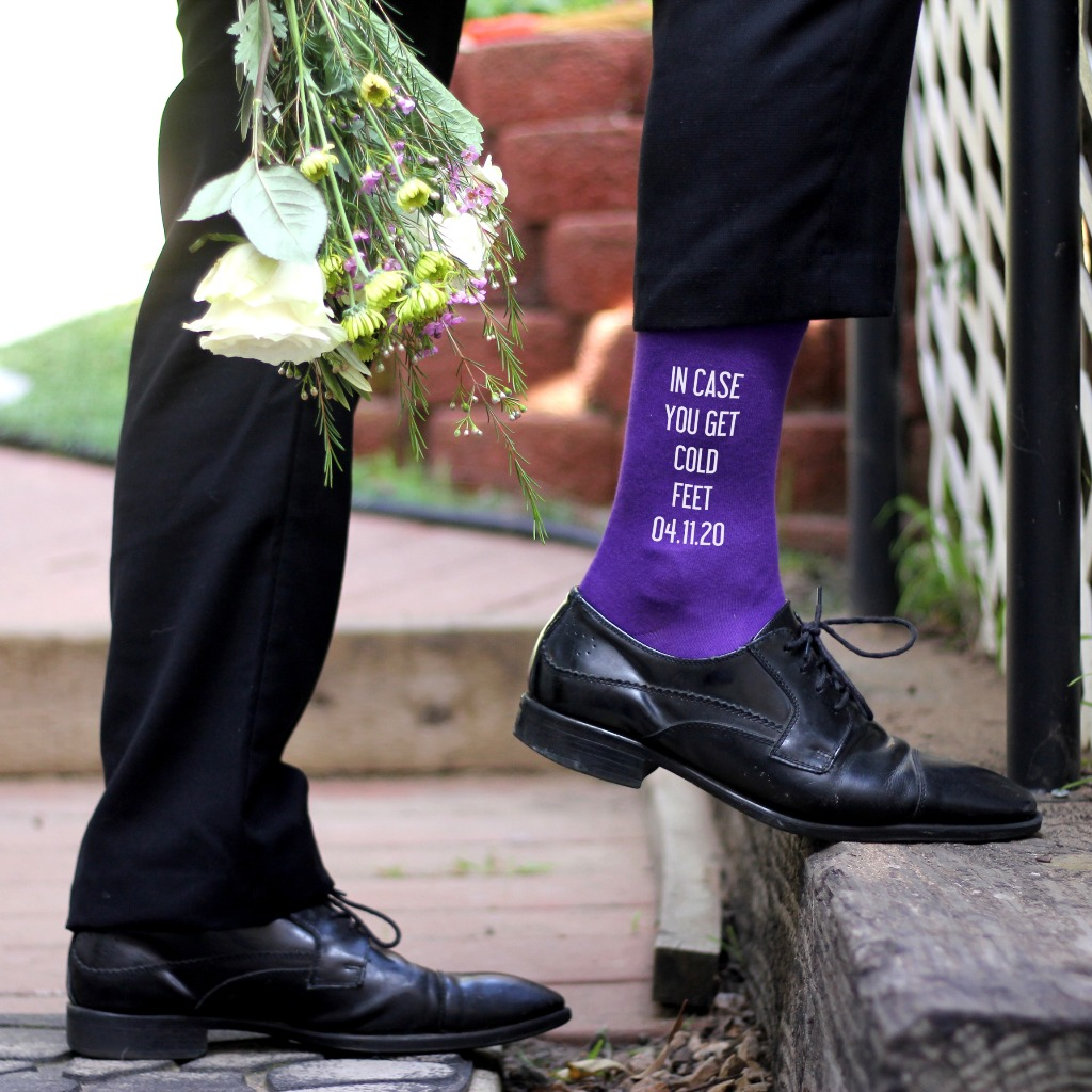 Perfect for the Groom. Printed on Men's black dress socks, this accessory is a warm wedding reminder, in case you get cold feet!