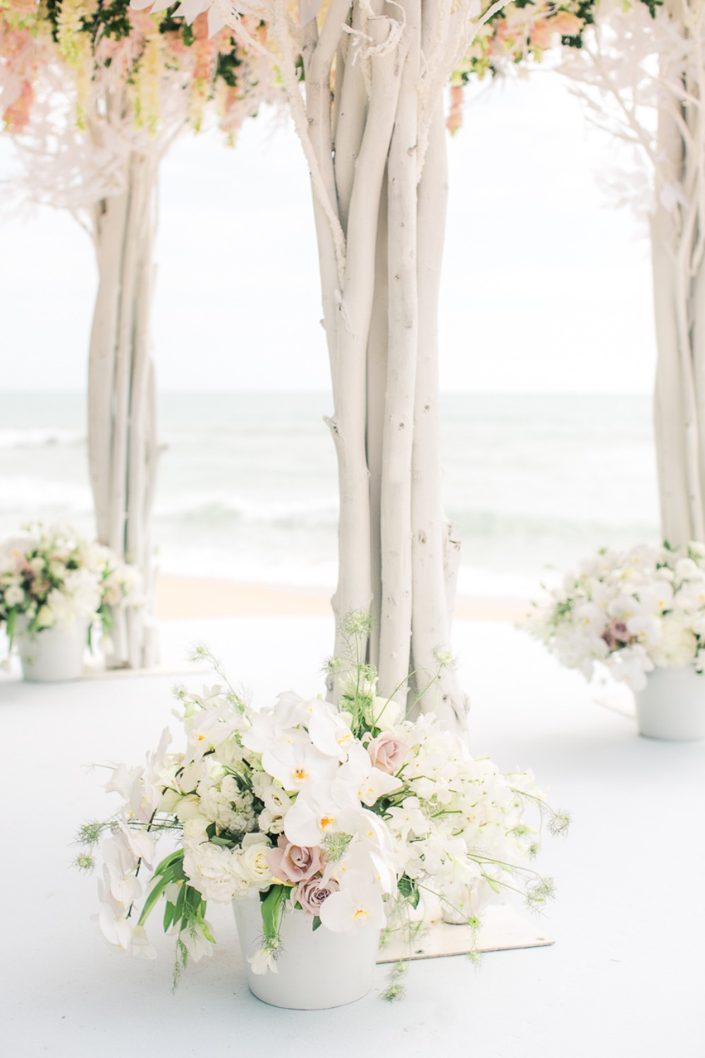 Ceremony florals for a beach wedding