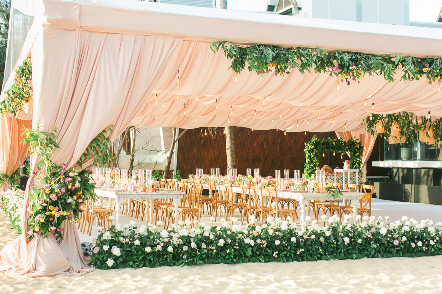 Outdoor tent reception on the beach