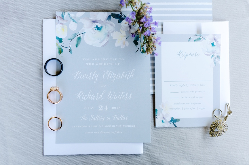 A dusty gray wedding suite featuring the most romantic bloom. Just, lovely!