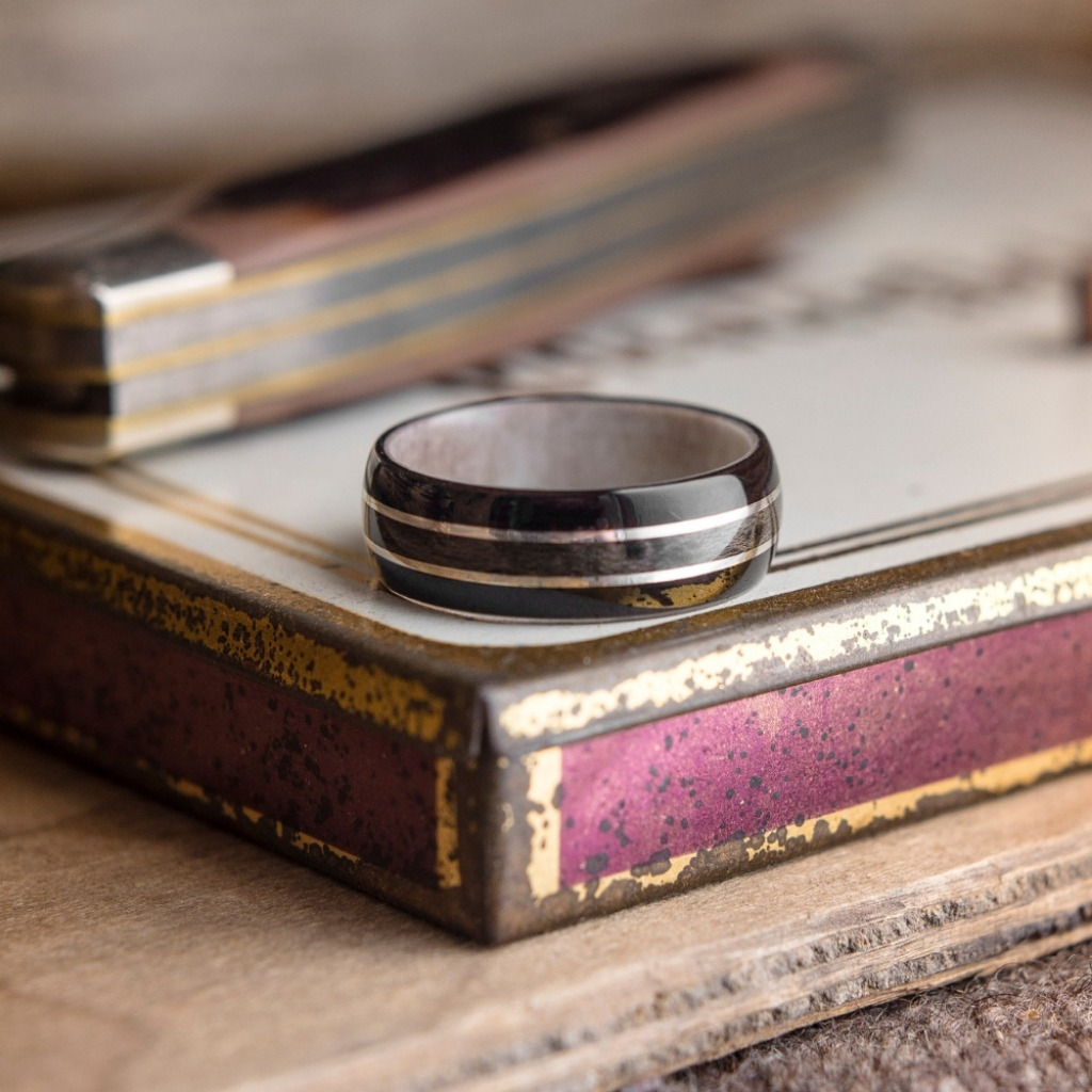 Another amazing bentwood wedding ring featuring a deer antler interior.