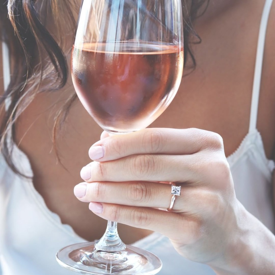 Bride drinking rose wine with MiaDonna ring