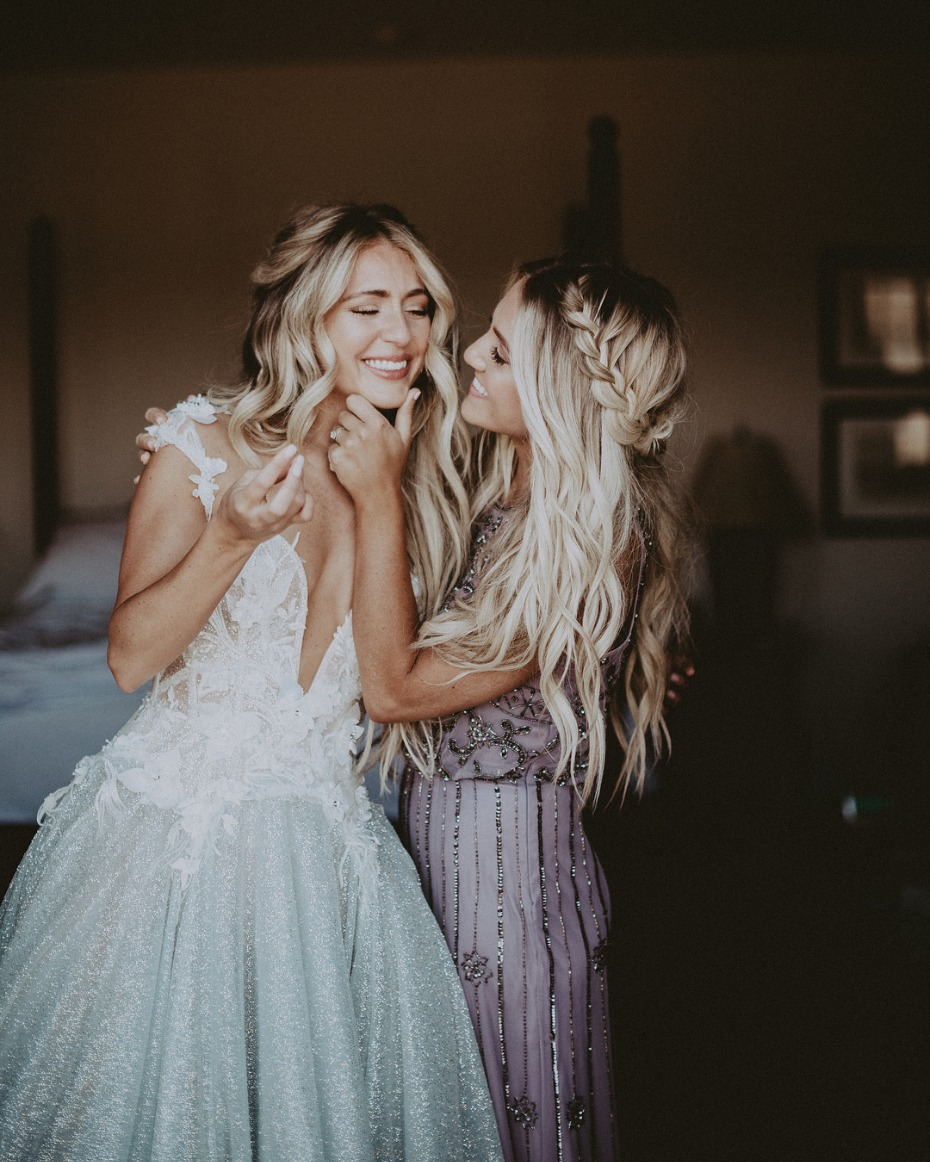 Bride and Maid of Honor Sister Helping Fix Her Makeup