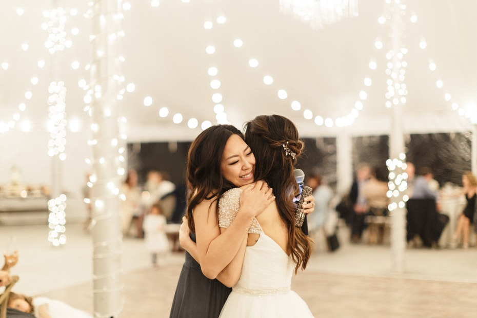 Maid of Honor Hugging Bride After Speech