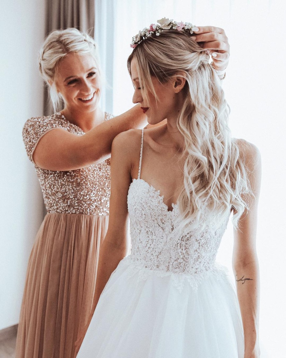 Maid of Honor Helping Bride Get Ready