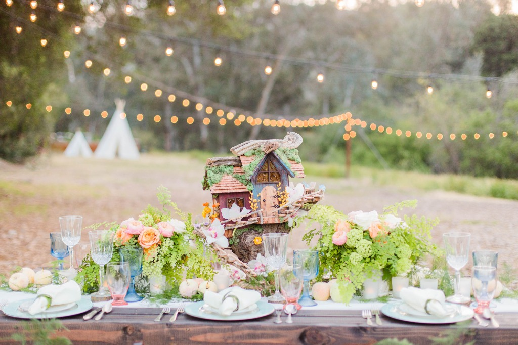 This rustic, woodland inspired look is picture perfect, with its twinkling lights and magical charm. Add in a few fairy and pixie houses