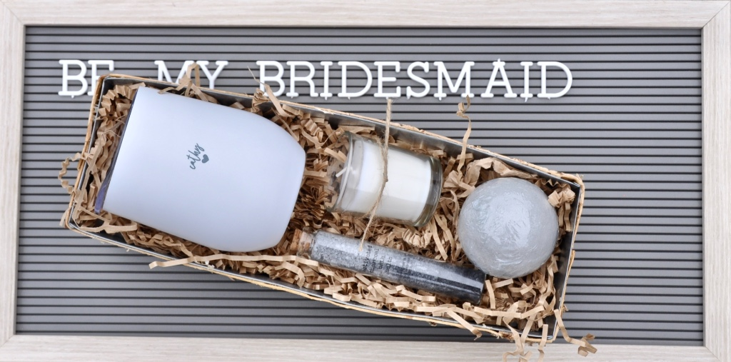 A will you be my bridesmaid box perfect for a luxe wedding. She will love the personalized wine tumbler and small batch-made spa goodies