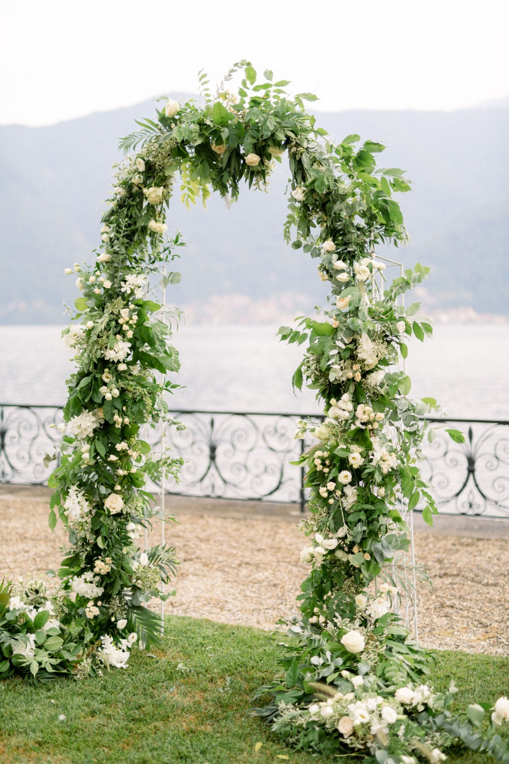 flower and greenery wedding arch