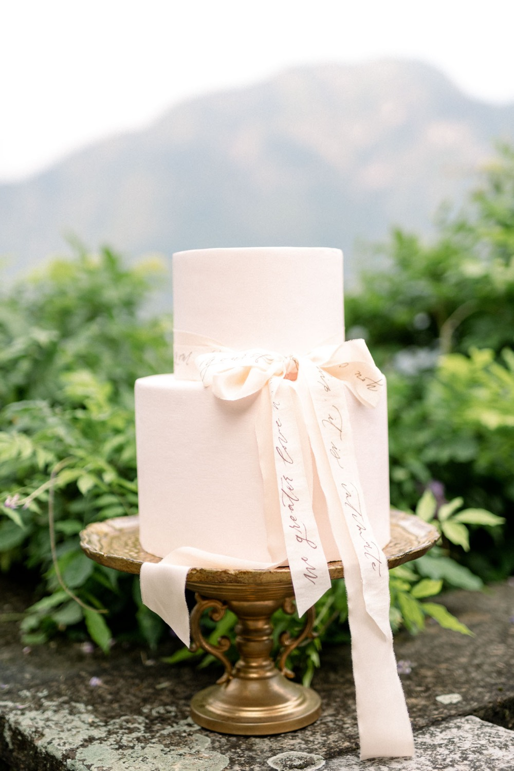 ribbon accented wedding cake