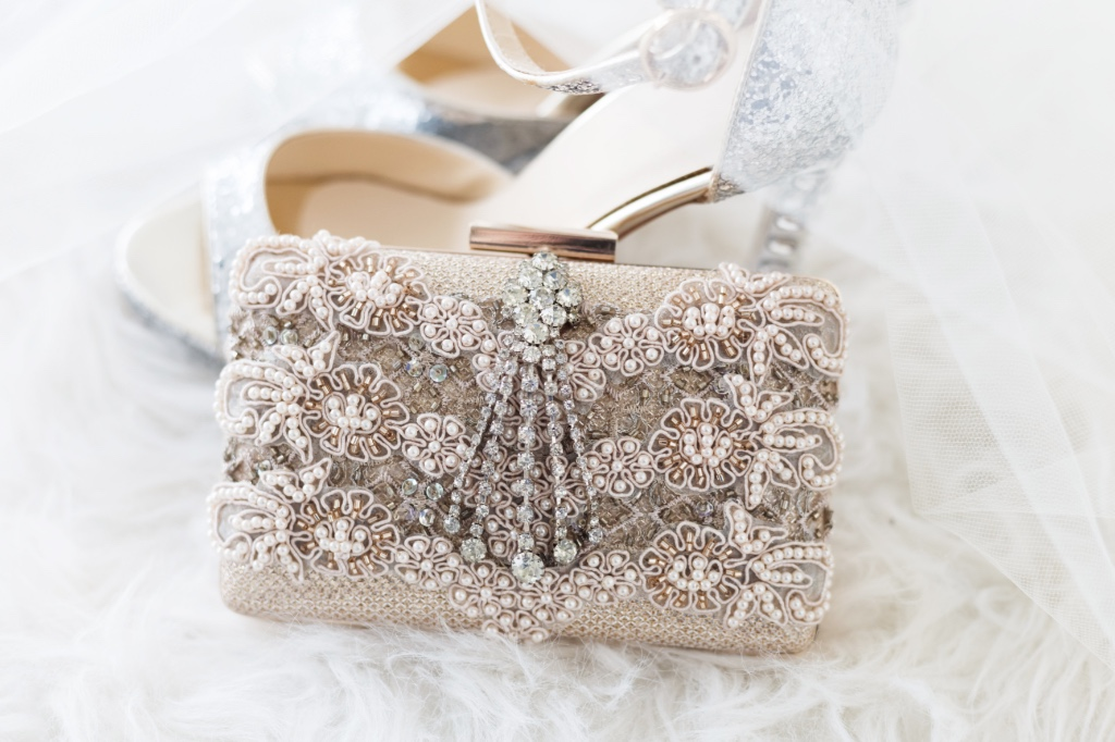 Pretty little blush details for the perfect Mother of the bride clutch