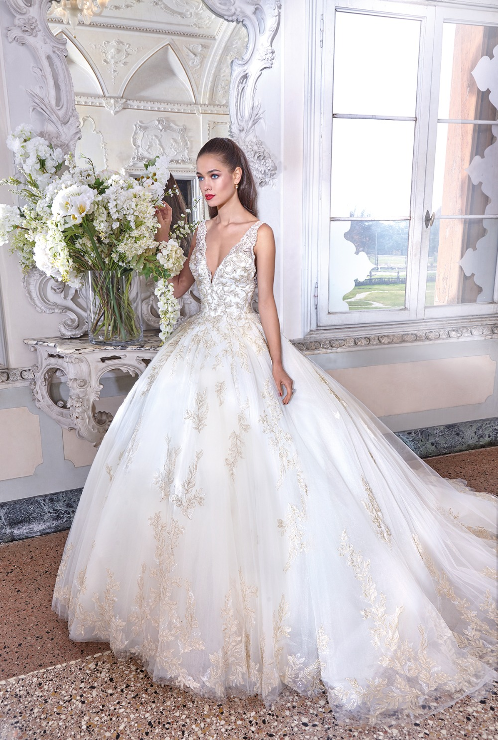 gold and tulle princess gown by Demetrios Platinum 19