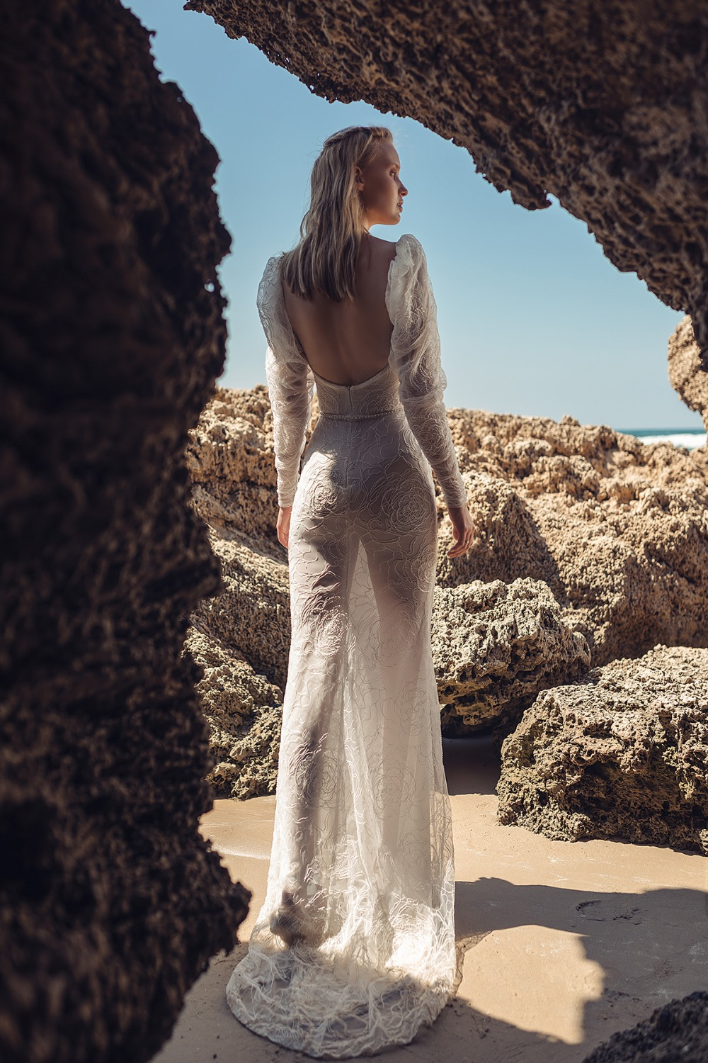 backless gown with dramatic puffed sleeves by Lilium