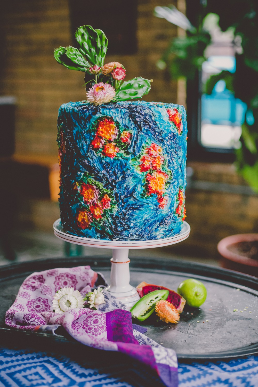 Colorful modern wedding cake with cactus topper