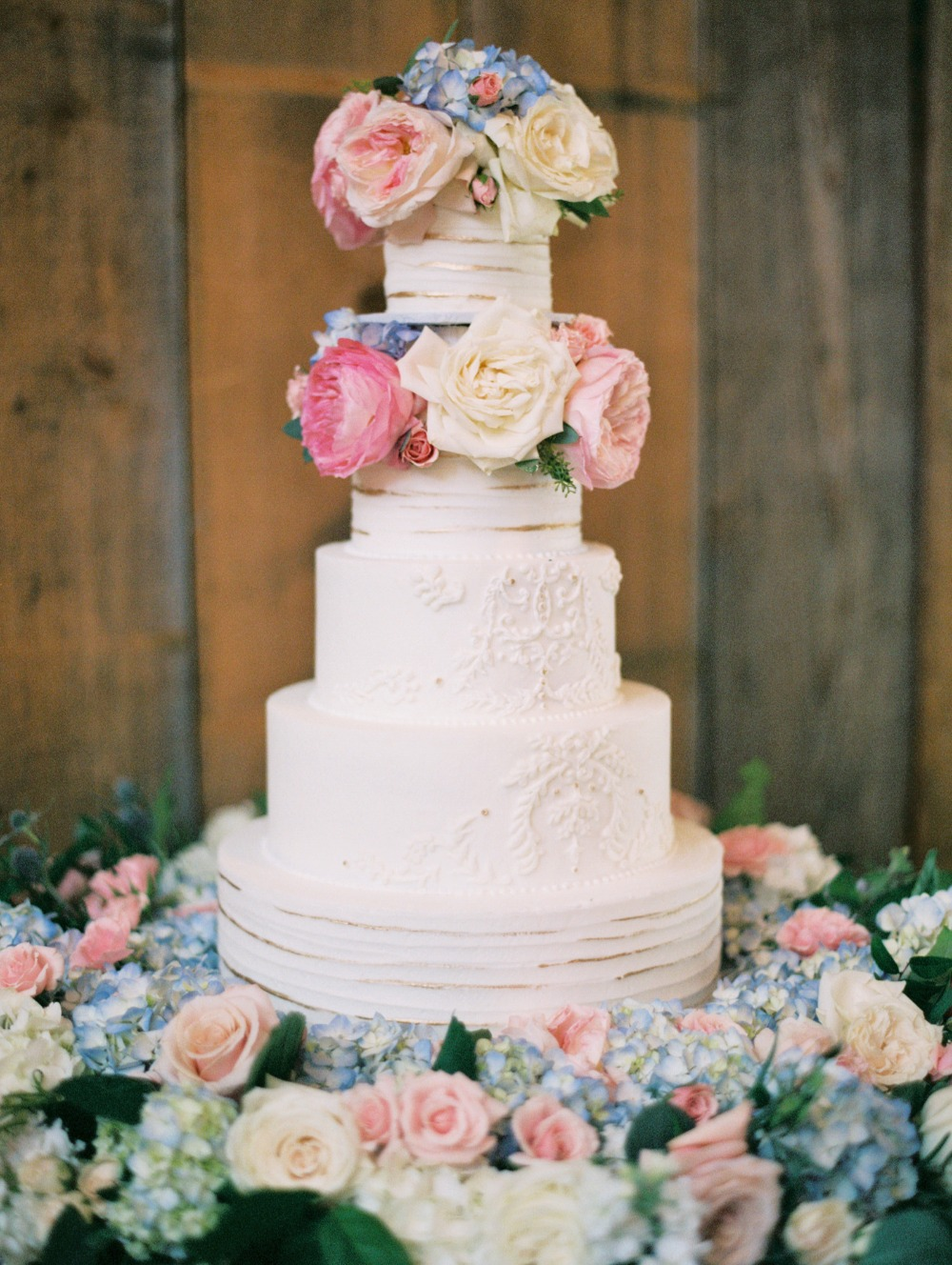 White and gold wedding cake with florals
