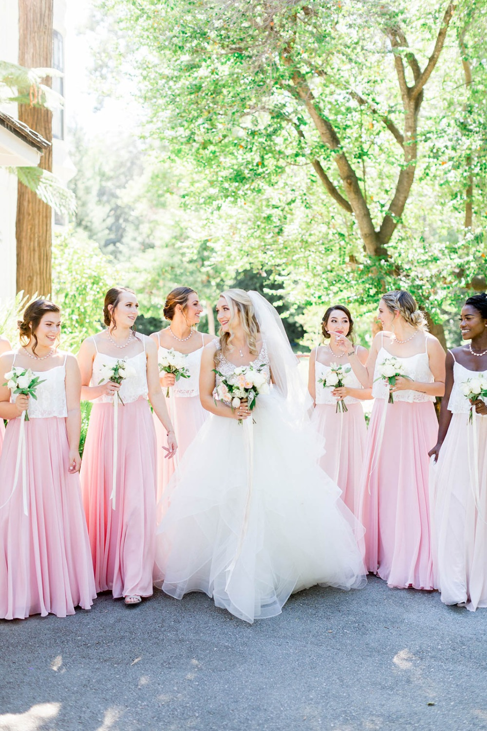 pink skirts and white cropped top bridesmaids