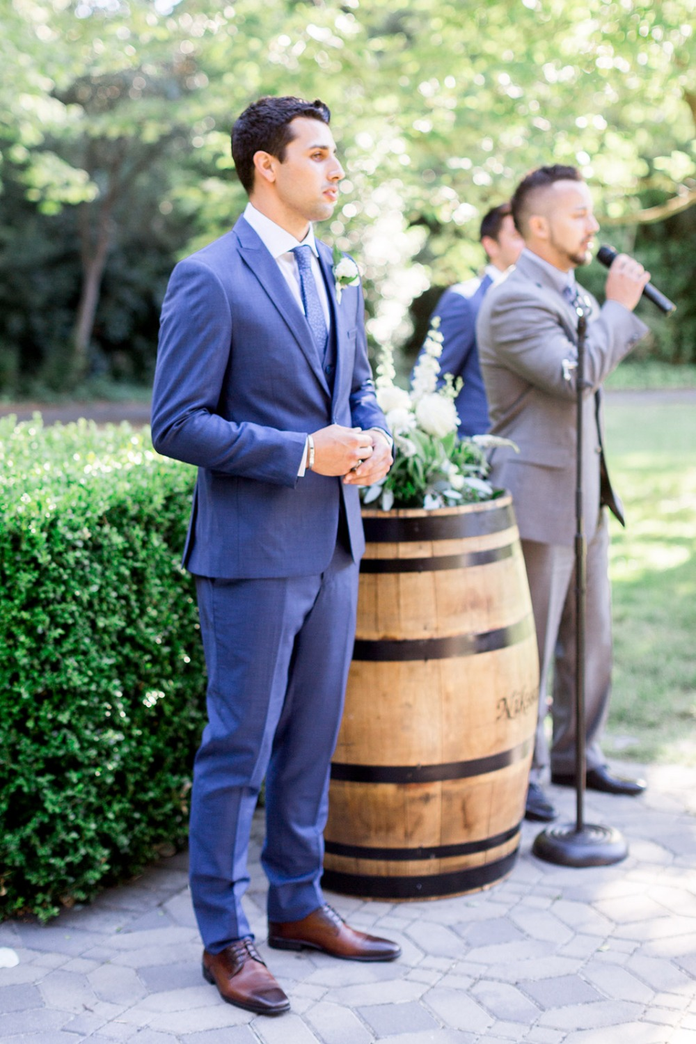 groom at the alter
