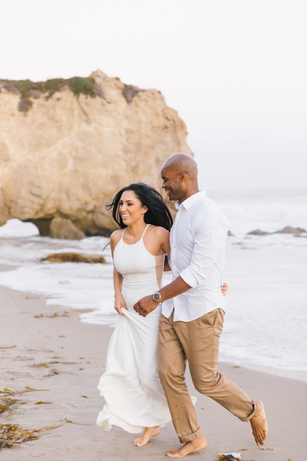 Loved the white and neutral outfits for this Malibu engagement session! It was fun to watch these two explore this gorgeous beach for