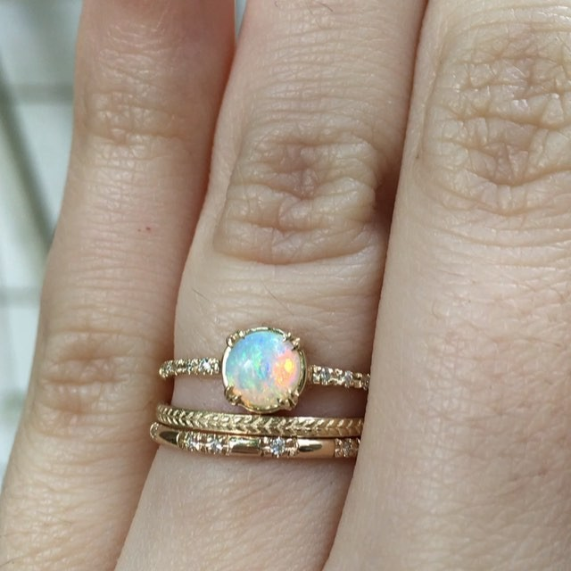 Feeling pretty wowed by our Else Opal ring this morning. Constellation band and wheat band look pretty darn cute too.