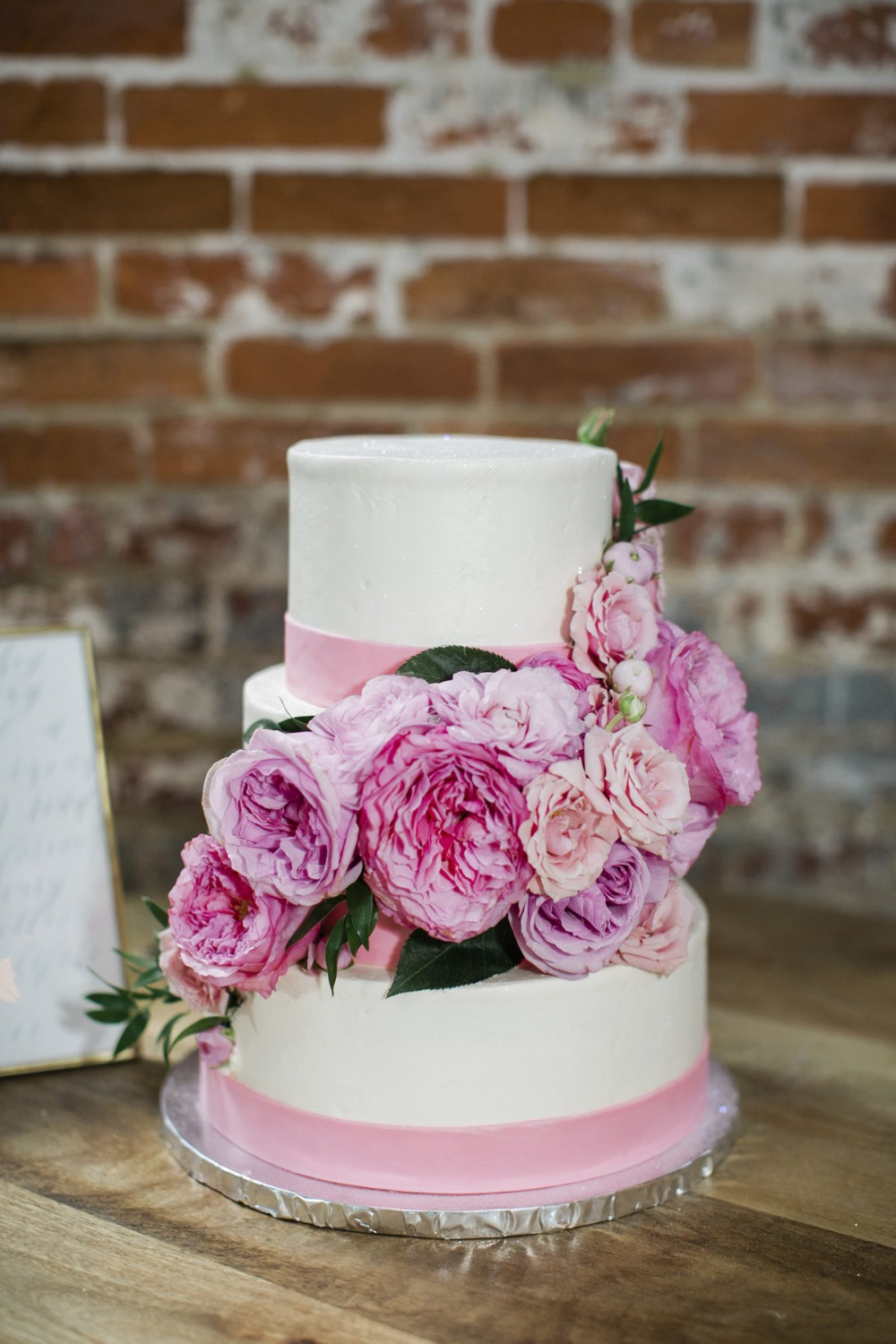 pink floral accented wedding cake