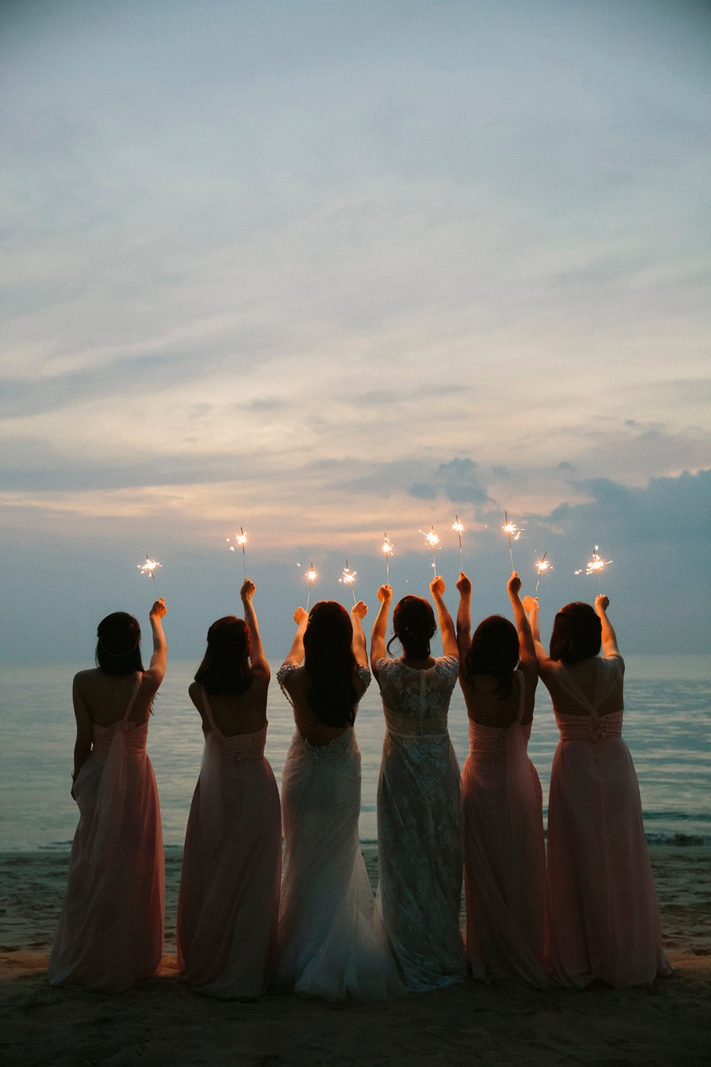 Sparklers and bridesmaids