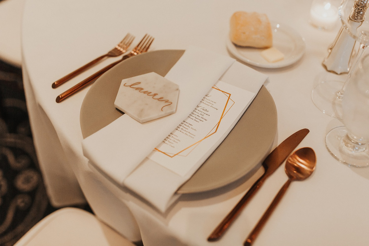 white and copper wedding place setting