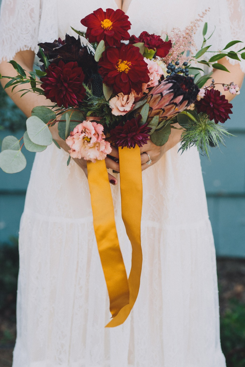 Wedding bouquet with yellow ribbon