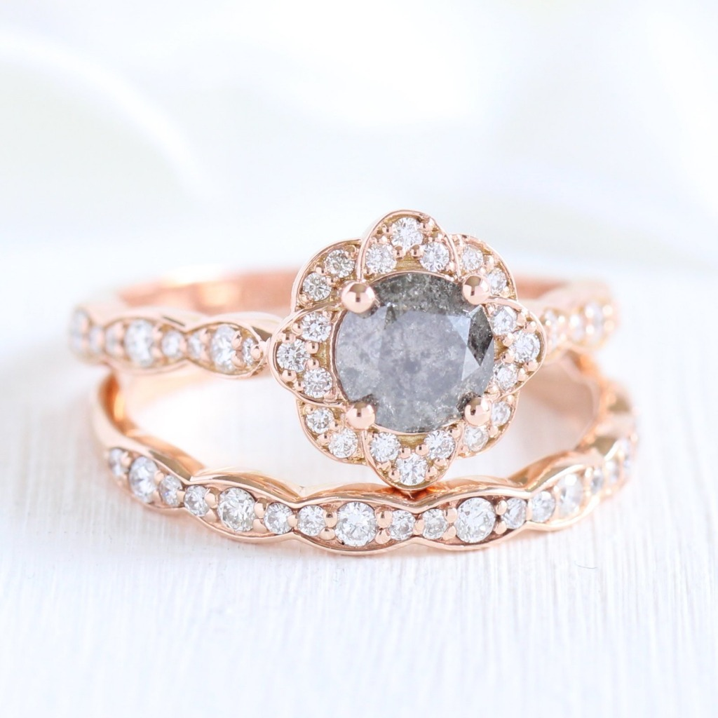 Beautifully crafted diamond bridal set of a vintage inspired grey diamond engagement ring with a round cut salt and pepper gray diamond
