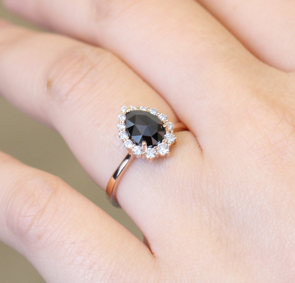Artfully handcrafted rose cut black diamond engagement ring in tapered band is crafted in 14k rose gold tiara halo diamond ring setting