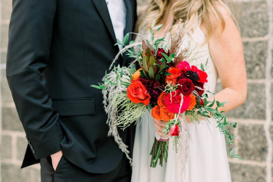Gantry Loft Long Island City Wedding Bride Holding Bold Red Bouquet