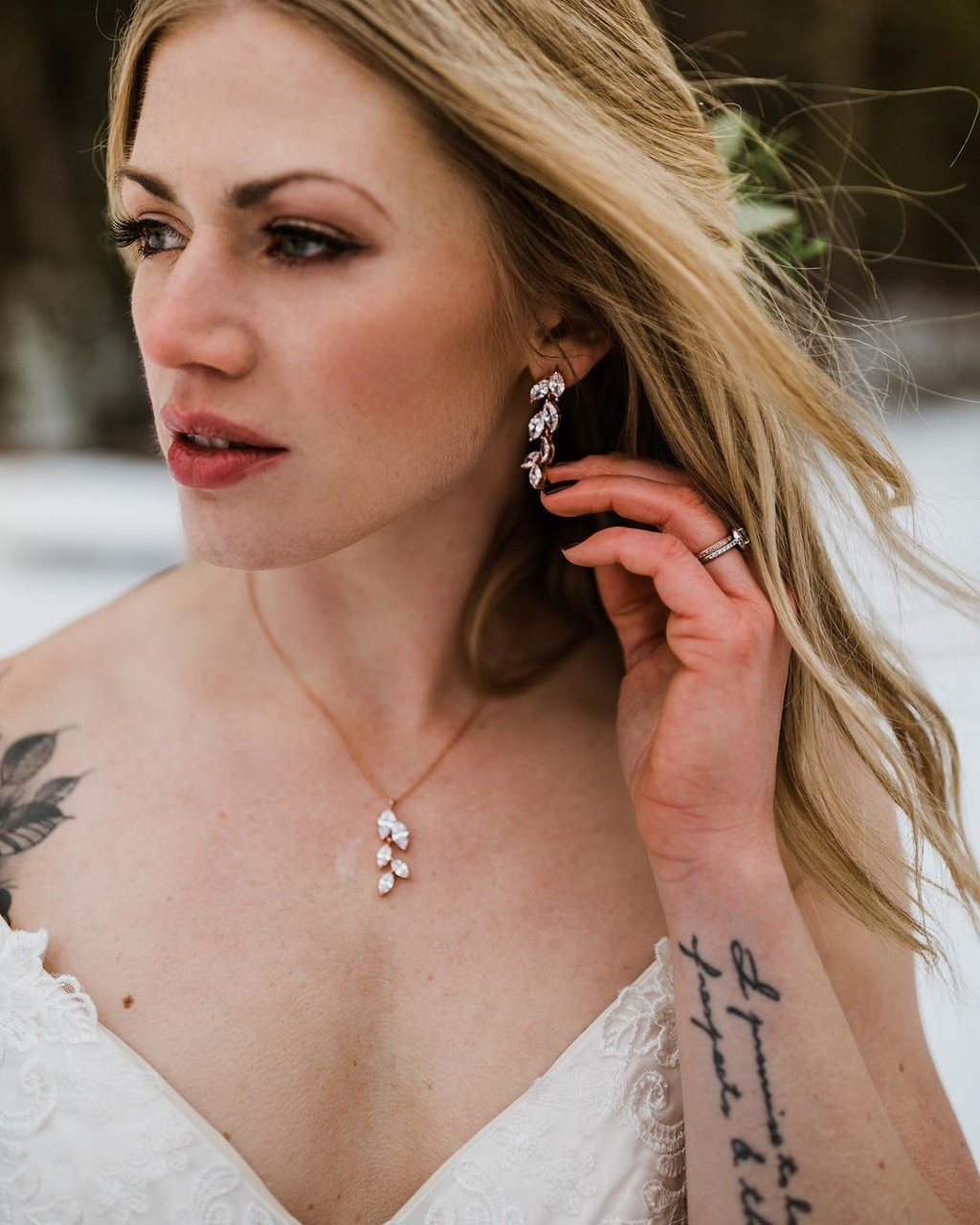 Stunning winter bride wearing 'AVITA' earring necklace set in rose gold. Available for purchase from Lottie-Da Designs on Etsy