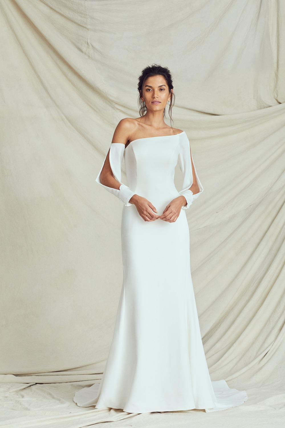 sleek gown with open sleeves by Kelly Faetanini