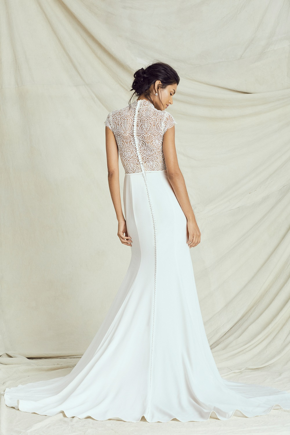 elegant laser cut top gown by Kelly Faetanini