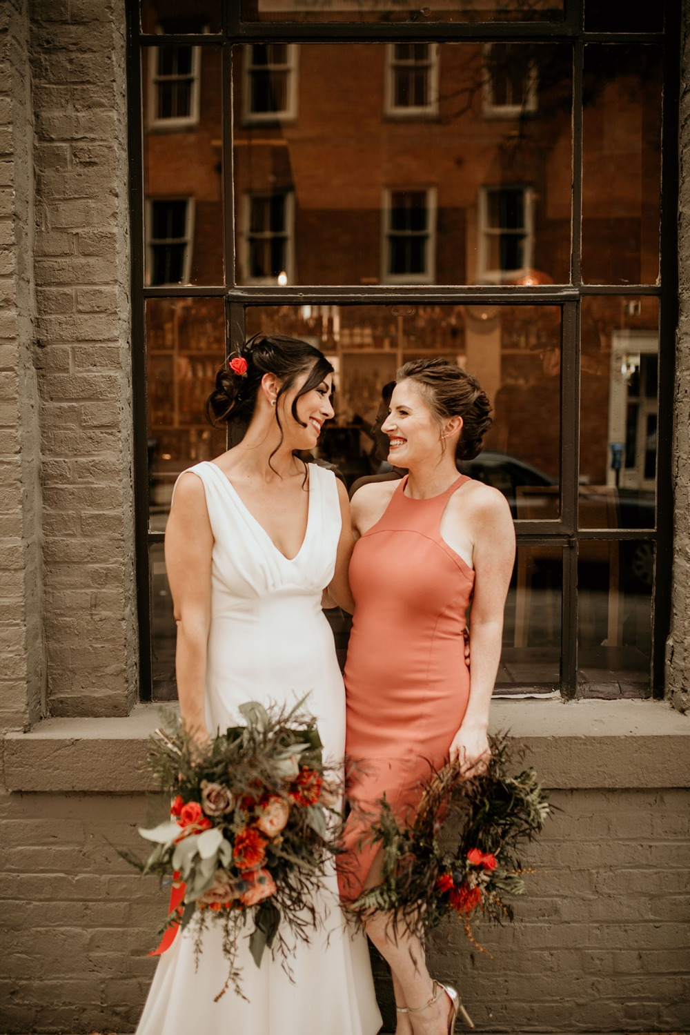 bride and her bridesmaid in coral