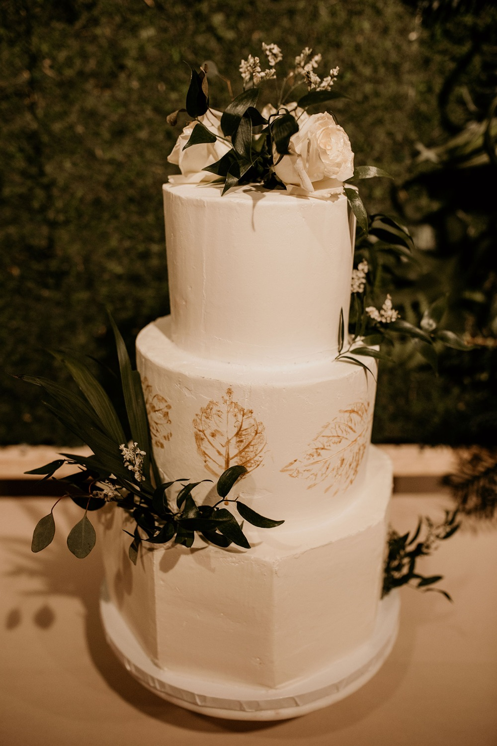 romantic white and gold wedding cake
