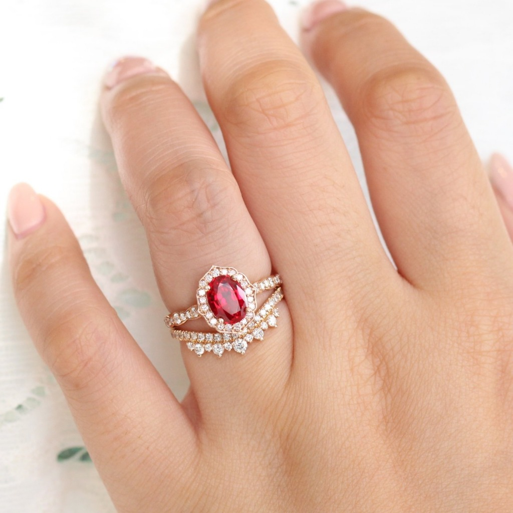Stunning one of a kind creation! This gorgeous ruby bridal set features a ruby engagement ring in 14k rose gold vintage floral diamond