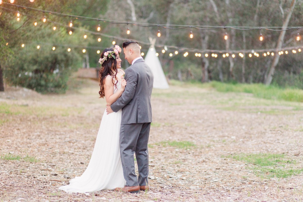 A sweet, romantic, first dance moment between our couple with the perfect rustic woodland backdrop behind them. We're in love!