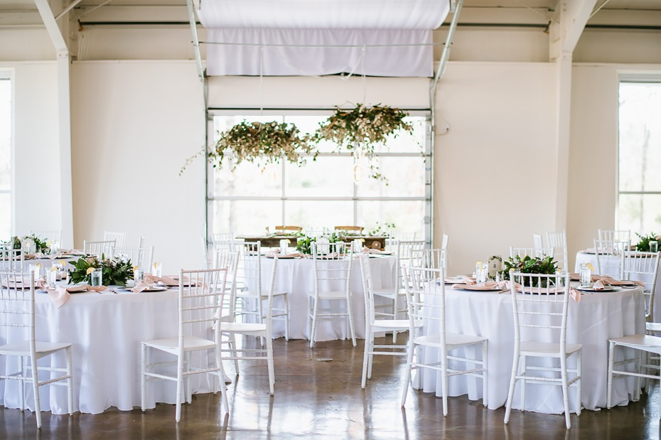 Whitewashed reception with greenery