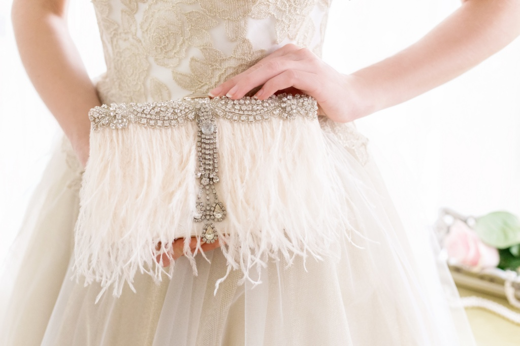 Unique and glamorous ostrich feather bridal clutches that sparkle.