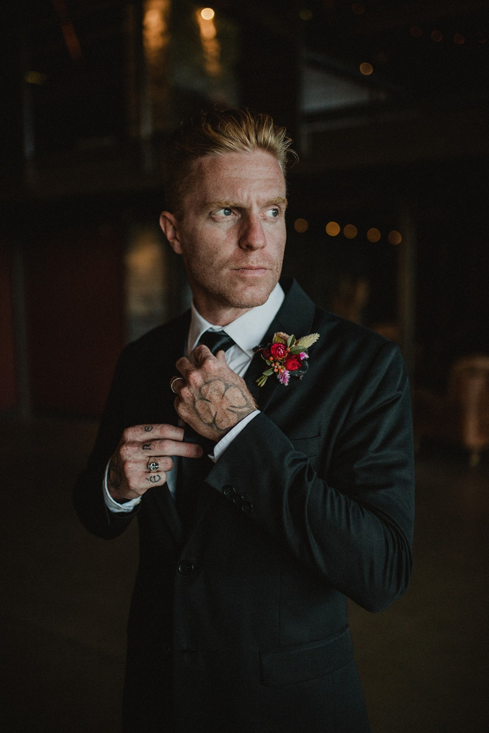 groom in sleek black suit