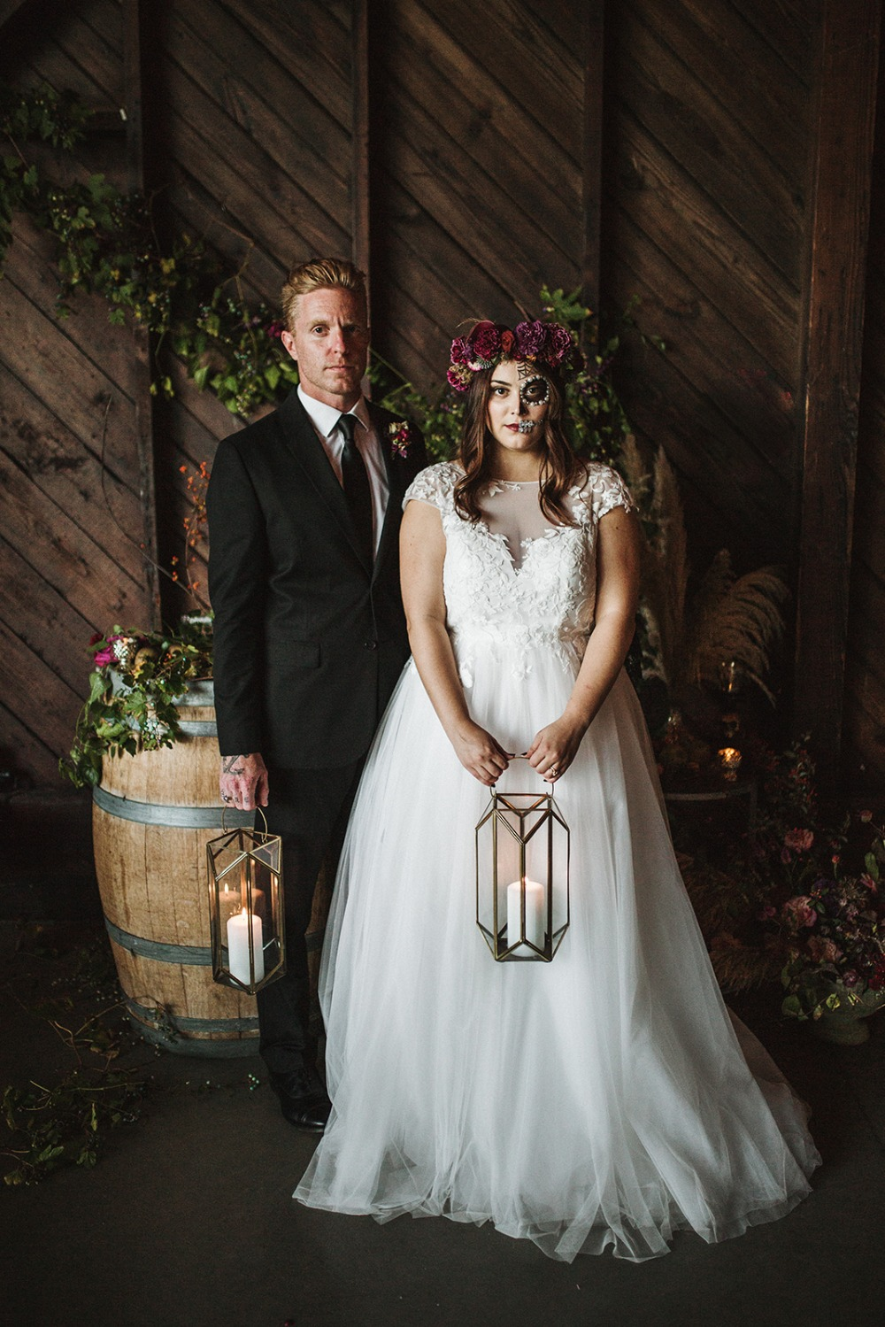 bride and groom with candle lit lanterns