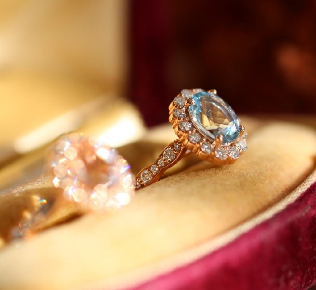 Something blue for your love ~ this gorgeous halo engagement ring in rose gold features an oval cut aquamarine set in halo diamond
