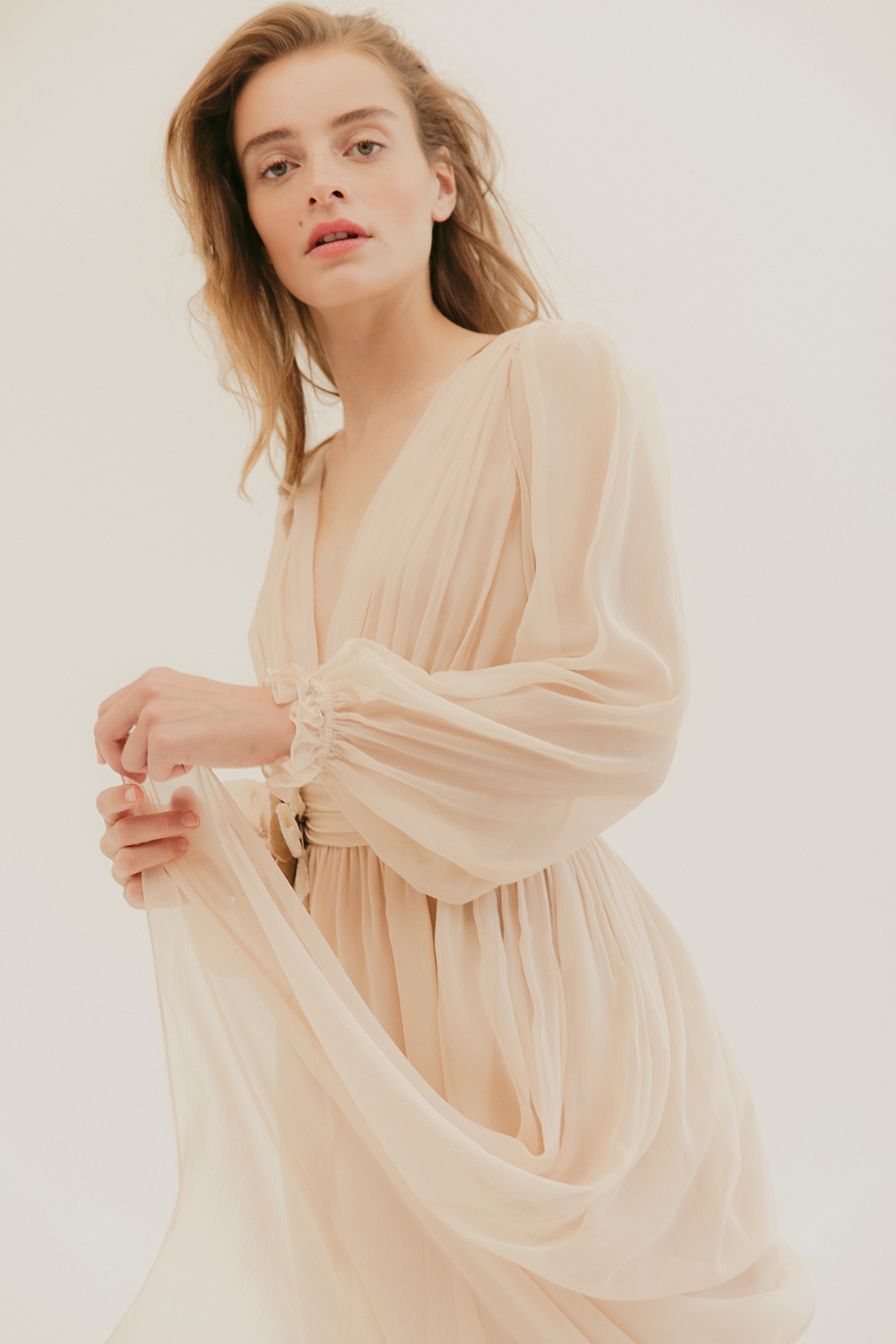 soft and flowing long sleeve dress by L. Wells