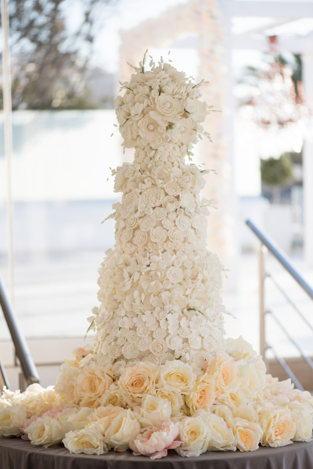 white flower covered cake