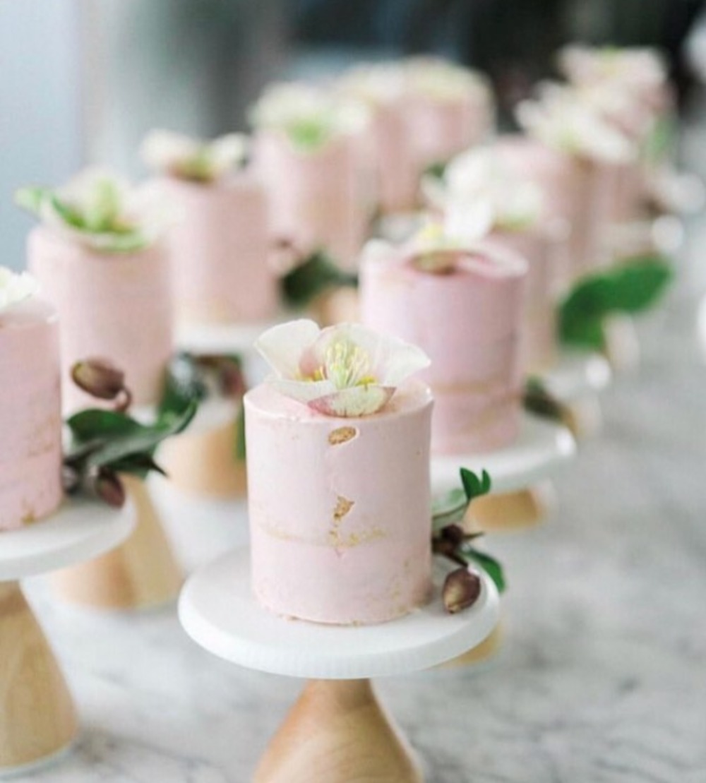 pink flower topped mini cakes by Cake Monkey Bakery