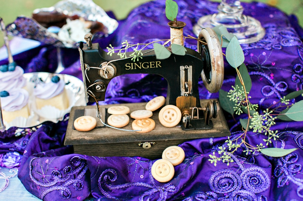 Botton cookies and a vintage sewing machine adds a unique touch to this Coraline inspired look that is fit for any Halloween wedding