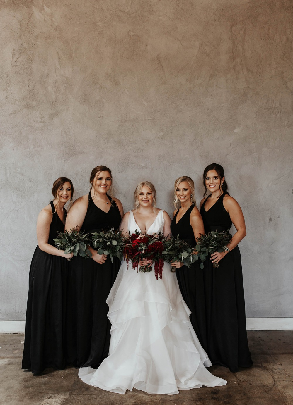 bride and her bridesmaids in all black