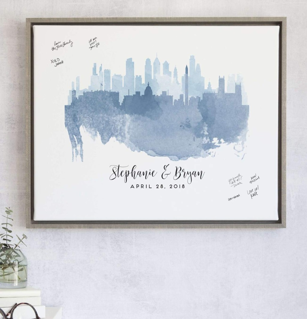 We love our Watercolor Skylines Guest Book Alternative with Custom Skyline because it's super meaningful and just a beautiful design