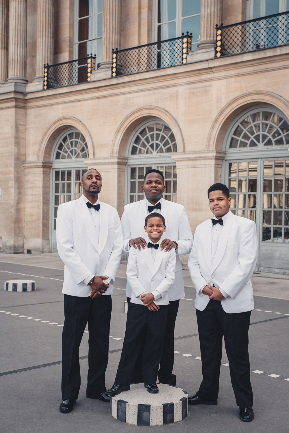 Groom and his men in white