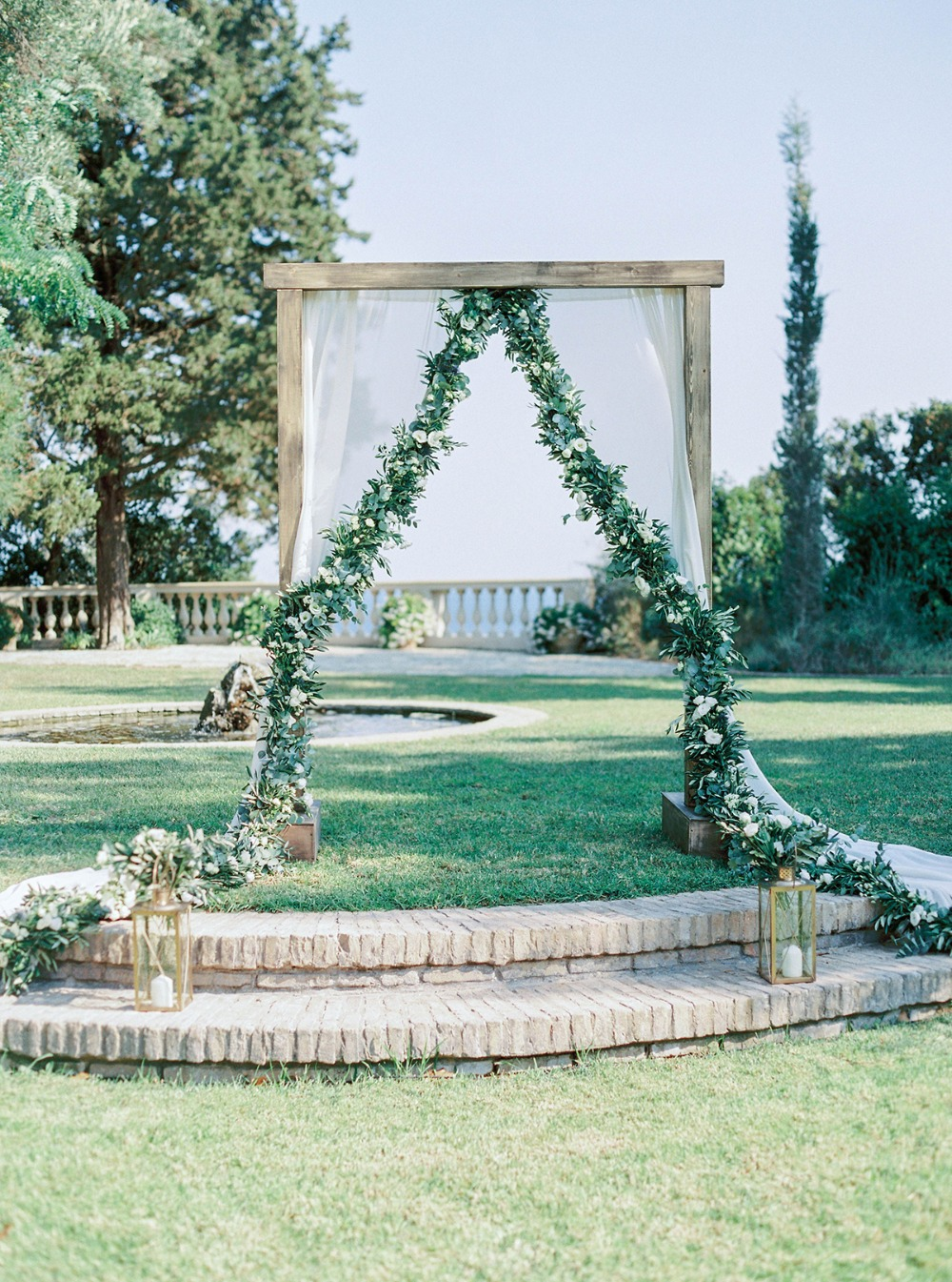 romantic curtain and floral garland wedding backdrop