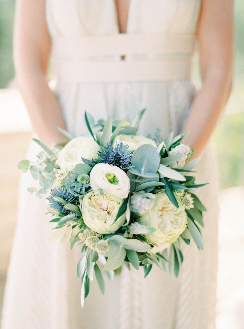 white and blue thistle wedding bouquet